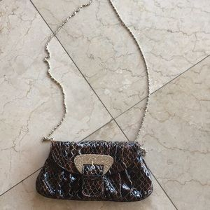 Brown clutch bag with strap
